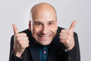 man making a silly face and giving thumb up